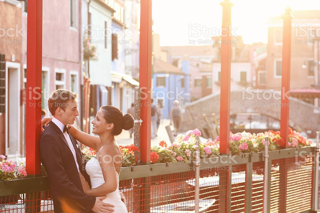 Bride and groom in Venice, having good time together stock photo