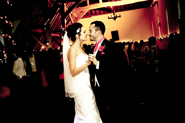 Bride and groom injoying their first dance stock photo