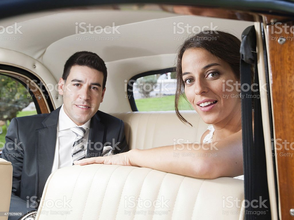Bride and groom inside a car stock photo