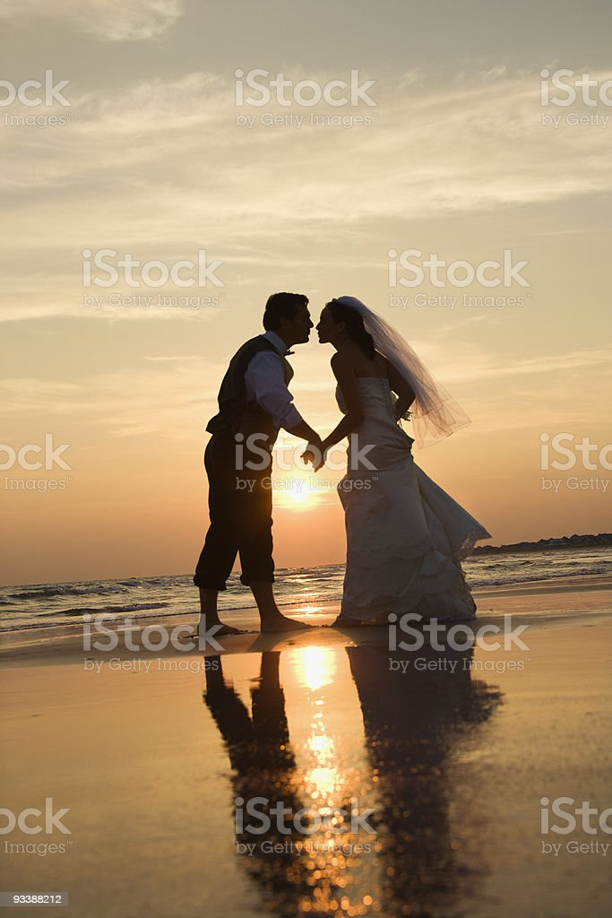 Bride and groom kissing on beach. royalty-free stock photo