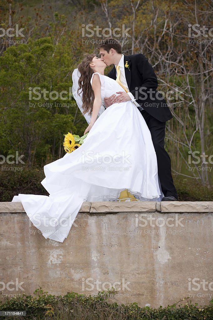 Bride and Groom Kissing on Rustic Old Wall royalty-free stock photo