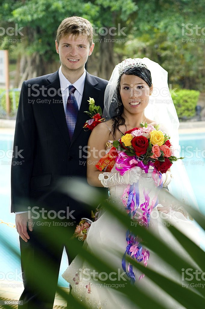 Bride And Groom Near the Swimming Pool royalty-free stock photo