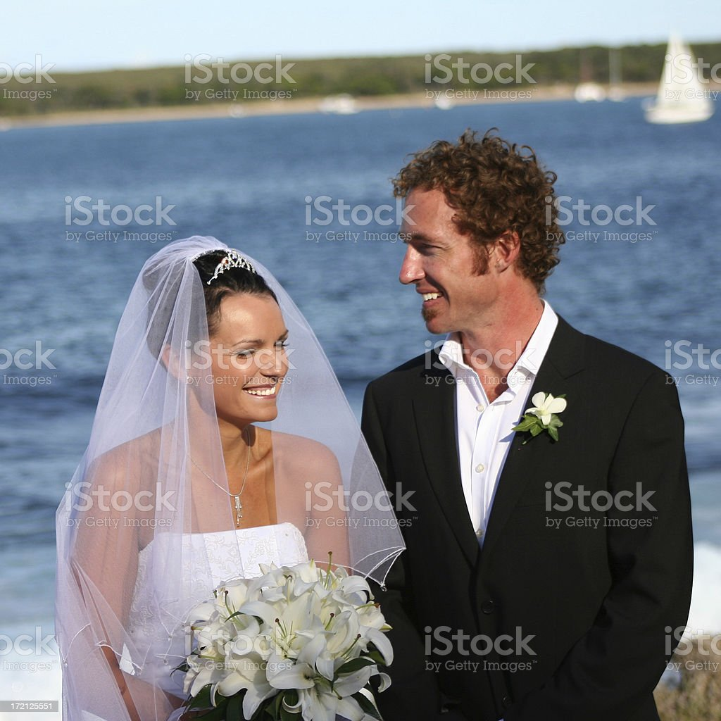 Bride and Groom next to the ocean royalty-free stock photo