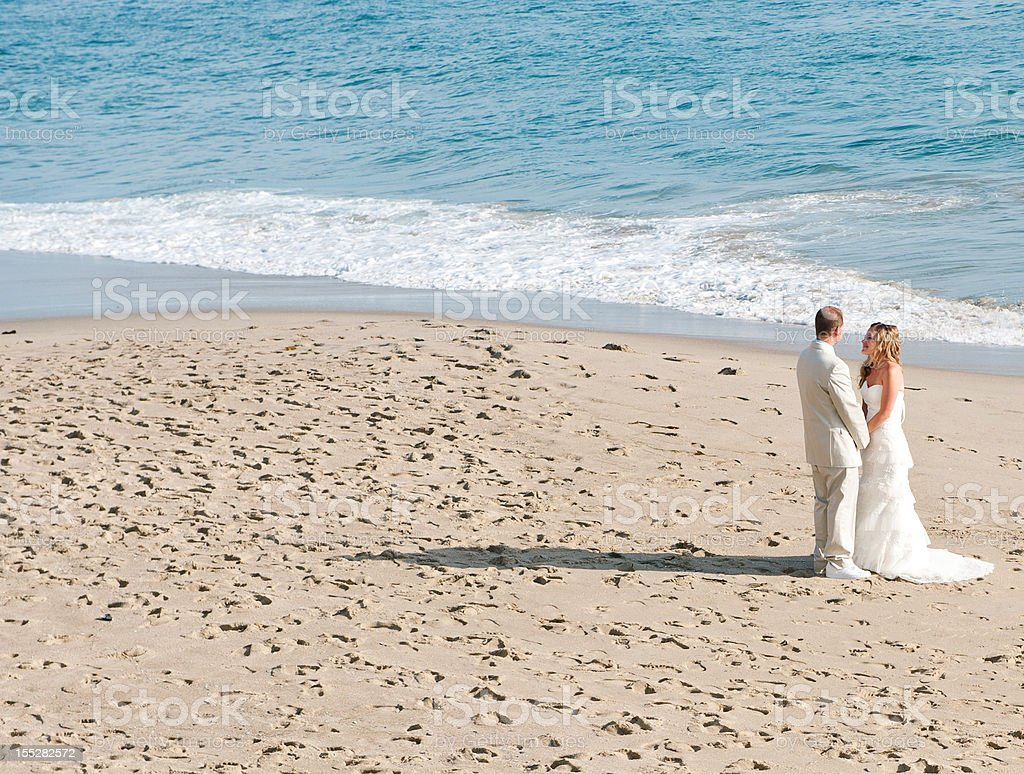 Bride and Groom on Beach royalty-free stock photo