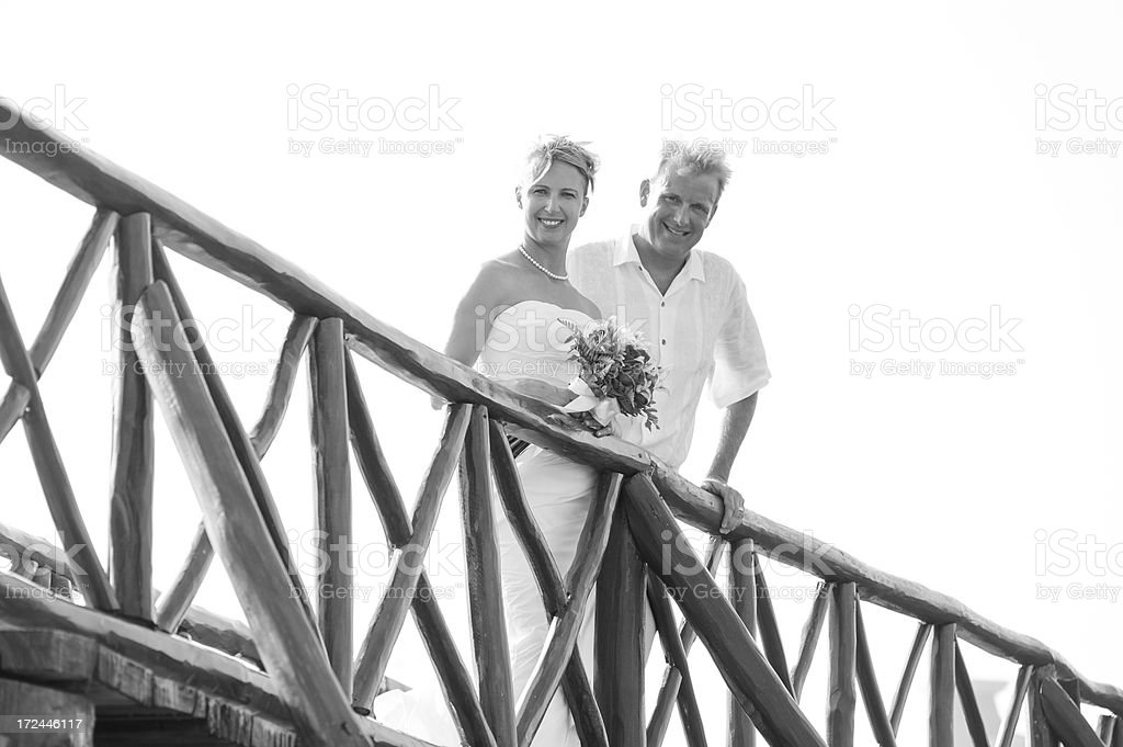 Bride and Groom on Bridge Looking Down royalty-free stock photo