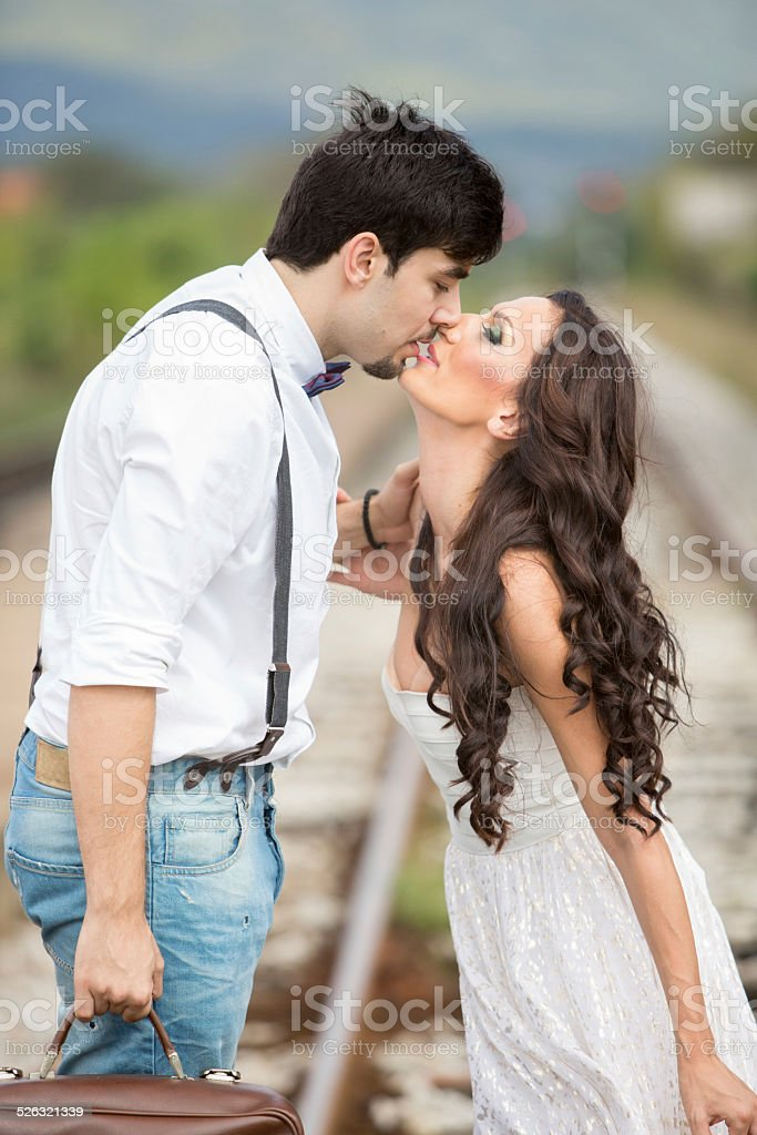 Bride and Groom on Railroad Track stock photo
