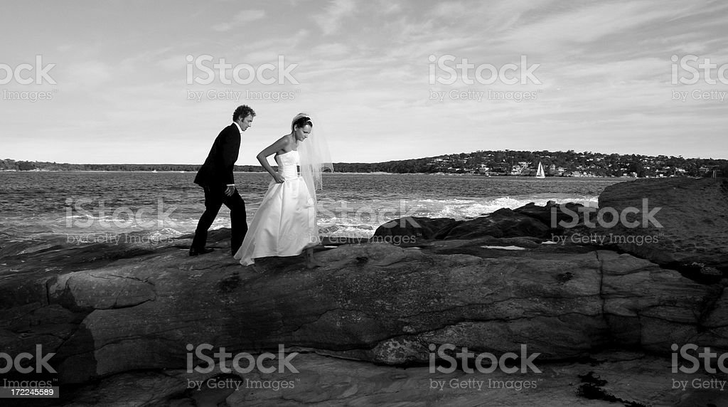 Bride and Groom on rocks royalty-free stock photo