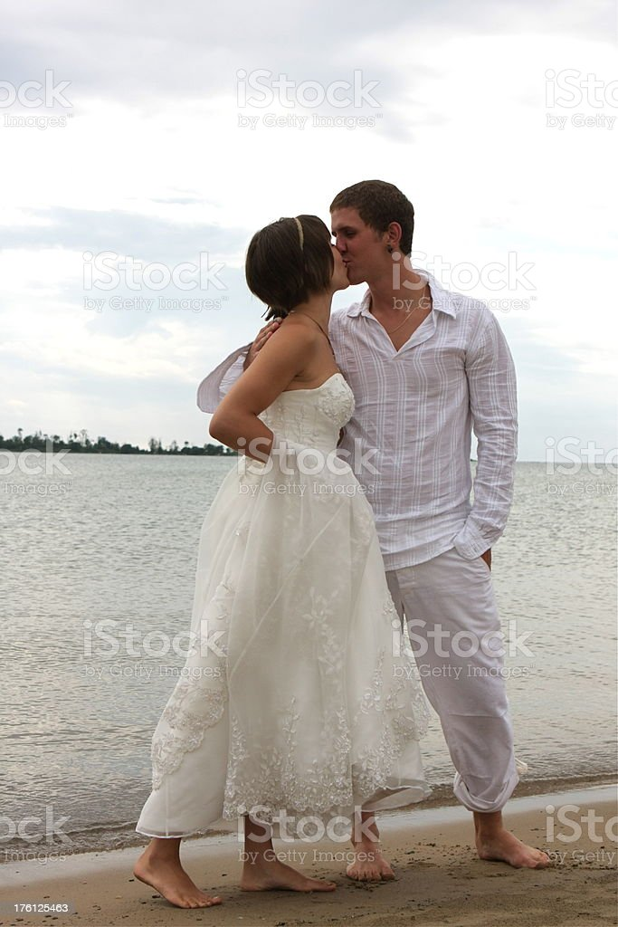 Bride and Groom on the Beach stock photo