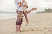 Pernambuco, Brazil, September 21, 2015: Bride and groom running on the beachPernambuco, Brazil, September 21, 2015: Bride and groom running on the beach