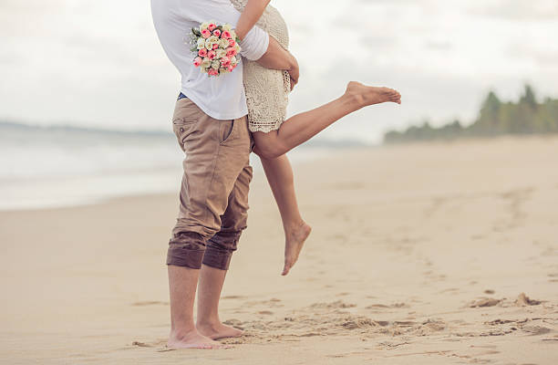 bride and groom on the beach - marriage stock photos and pictures