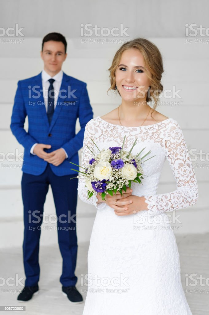 Bride and groom on their wedding day. Engagement of newlyweds. Girl in wedding dress. stock photo