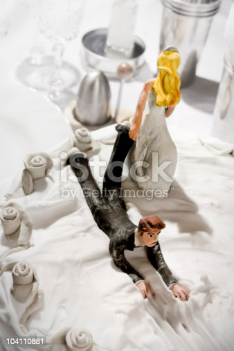 istock Bride and Groom on wedding cake 104110881