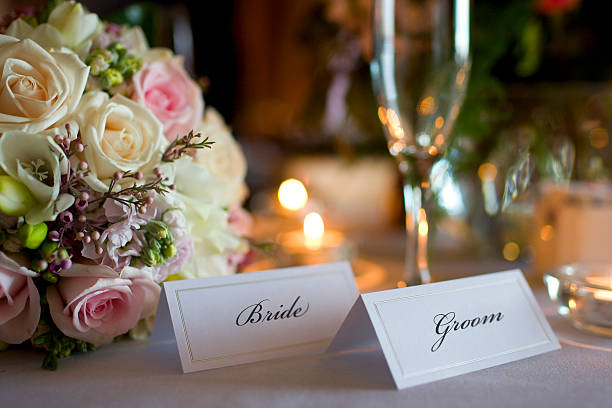 Bride and Groom Place Cards with Bouquet at Wedding Reception stock photo