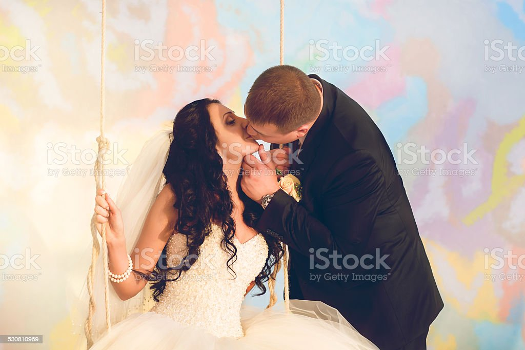 Bride and groom posing in the studio stock photo