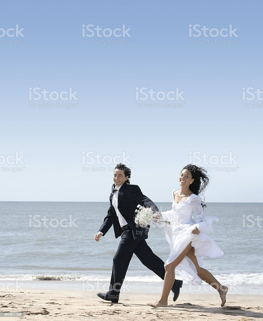 Marvelous Bride And Groom Running At The Beach Stock Photo More Download Free Architecture Designs Scobabritishbridgeorg