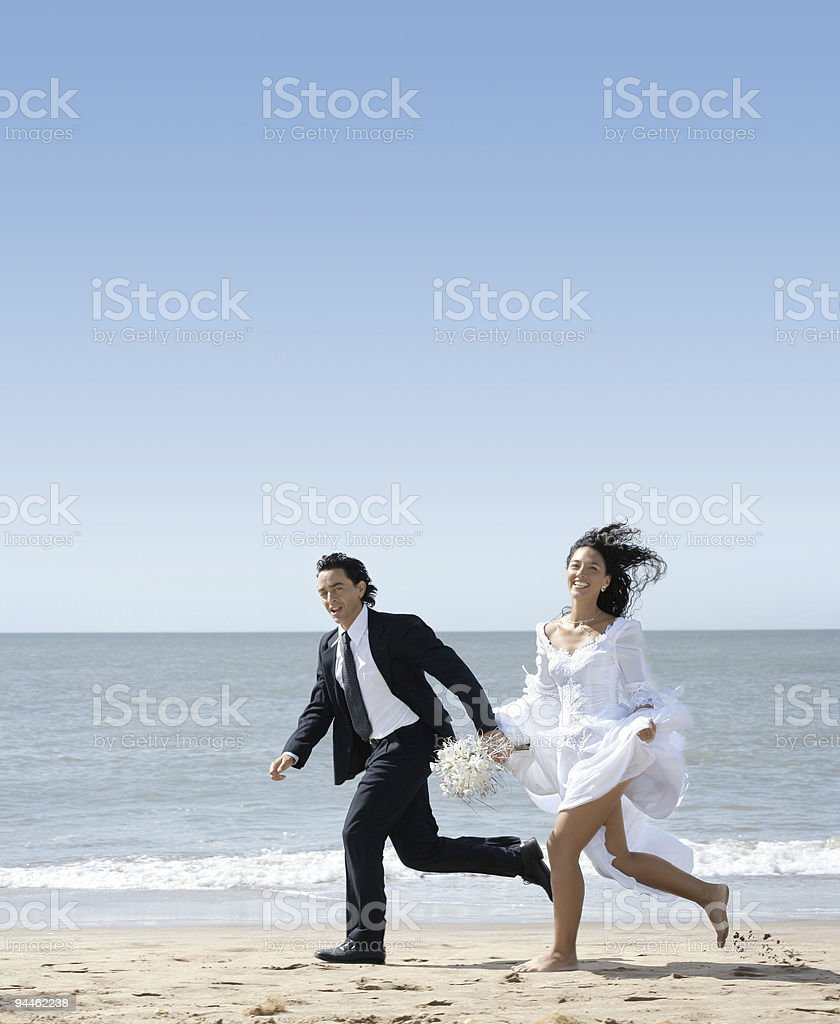 Surprising Bride And Groom Running At The Beach Stock Photo Download Download Free Architecture Designs Scobabritishbridgeorg