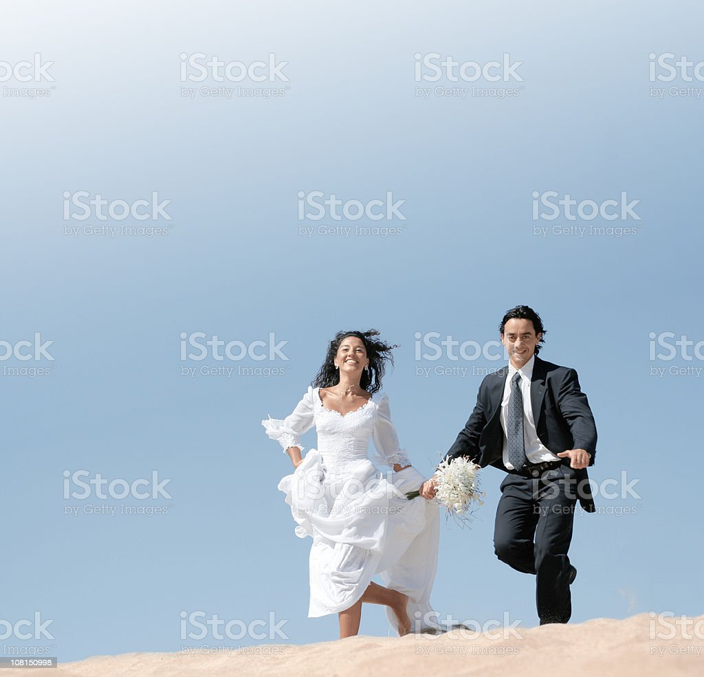 Stupendous Bride And Groom Running In The Dunes Stock Photo Download Download Free Architecture Designs Scobabritishbridgeorg