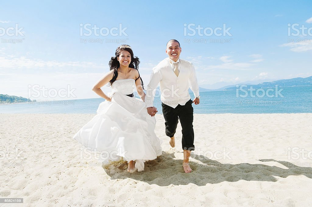 Fine Bride And Groom Running On The Beach Stock Photo More Download Free Architecture Designs Scobabritishbridgeorg