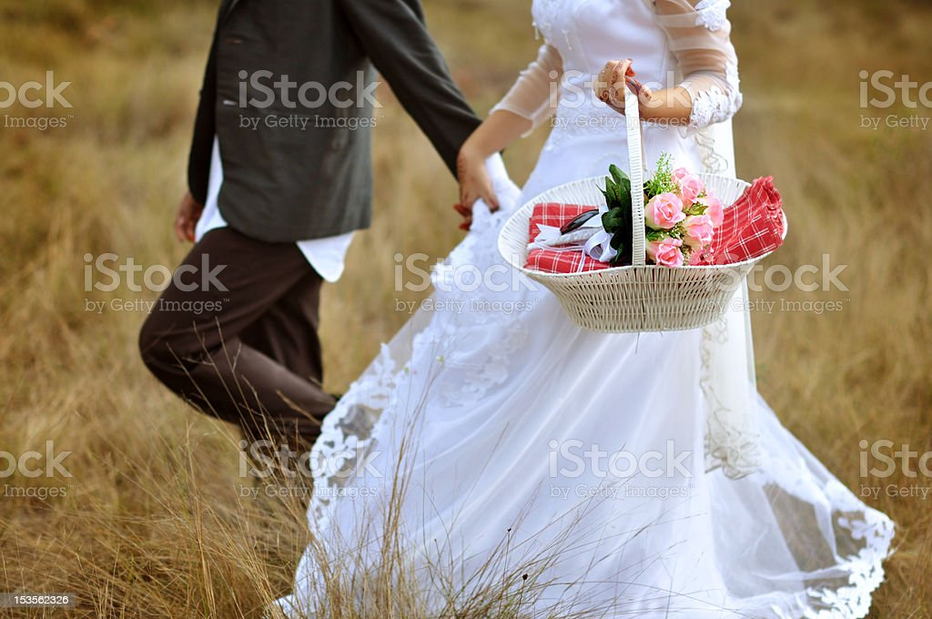 Bride and groom running royalty-free stock photo