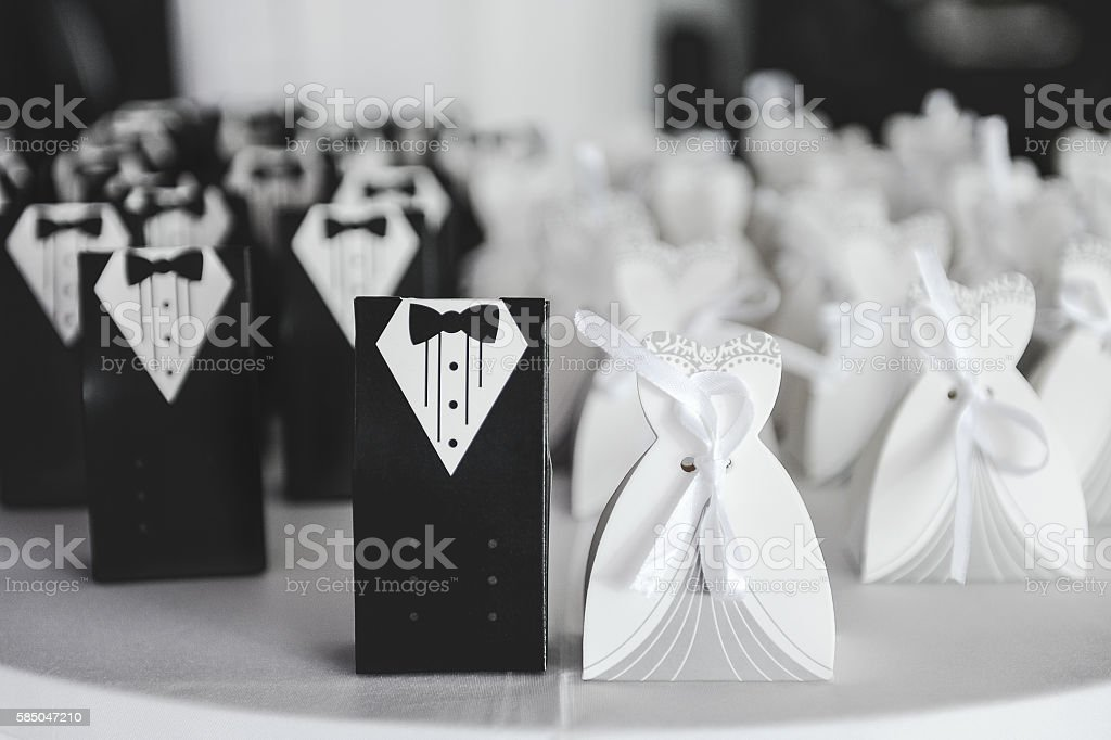 Bride and groom suit and dress cards stock photo