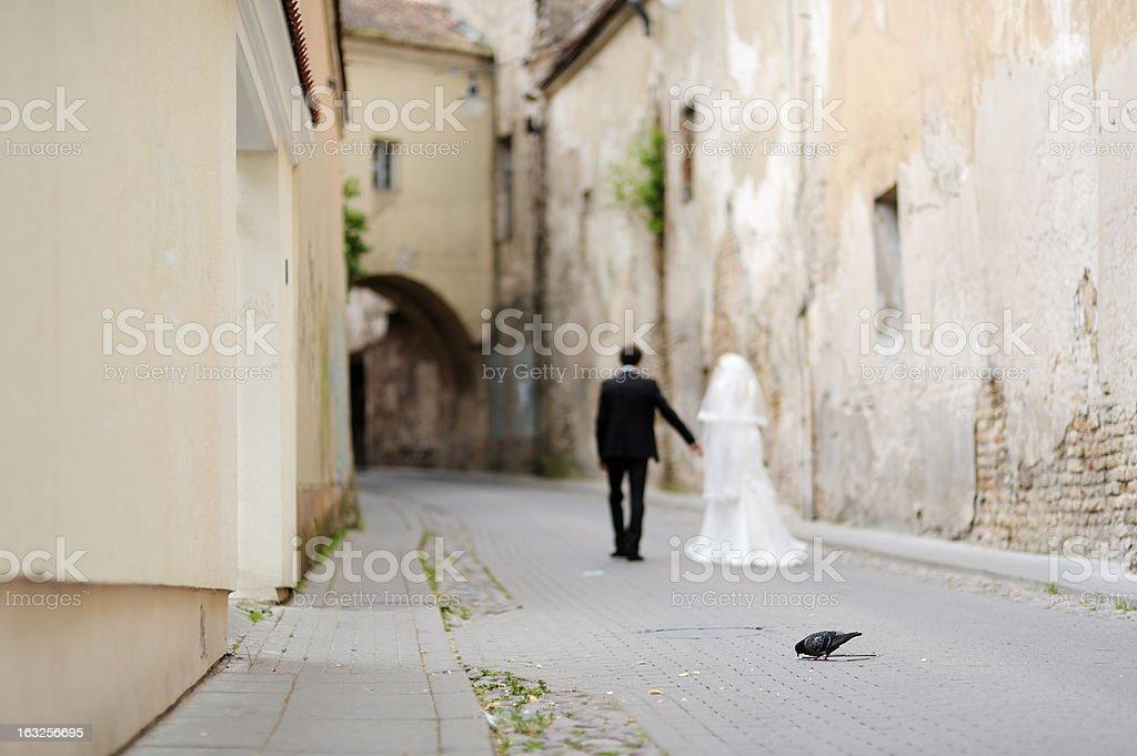 Bride and groom walking away royalty-free stock photo