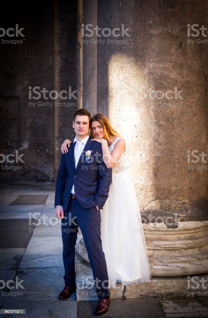Bride and groom wedding poses in front of Pantheon, Rome, Italy zbiór zdjęć royalty-free