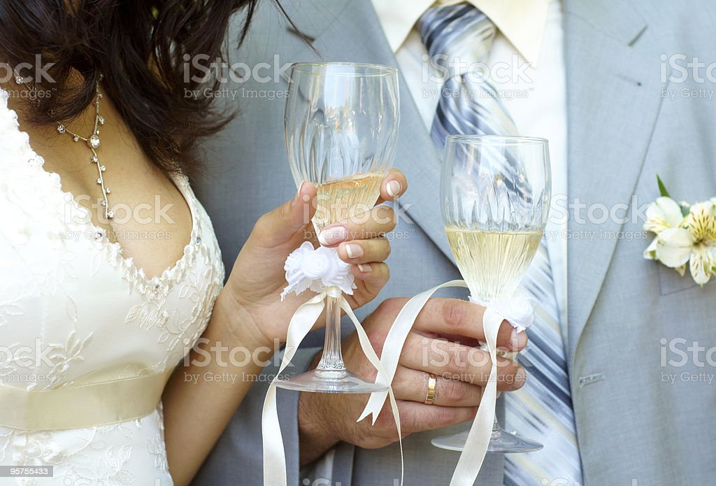 Bride and groom with champagne royalty-free stock photo