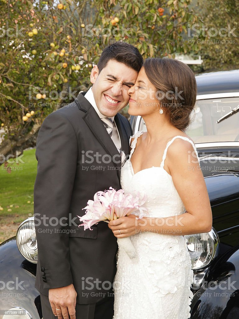 Bride and groom with funny expression stock photo
