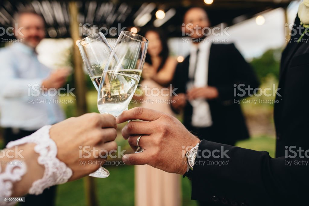Bride and groom with glasses of champagne stock photo