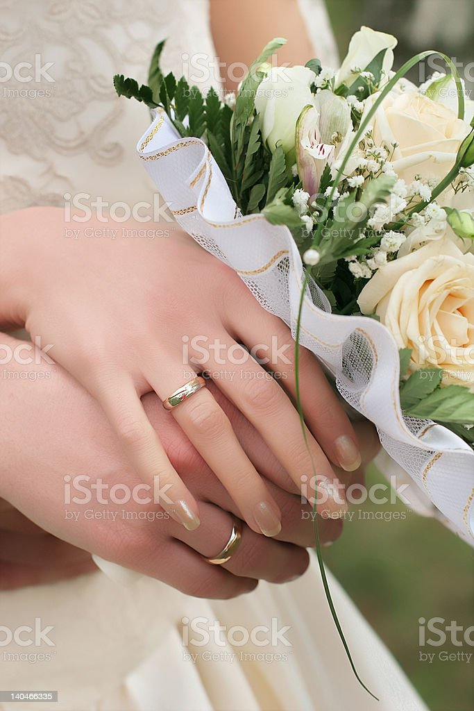 Bride and grooms hands with rings royalty-free stock photo