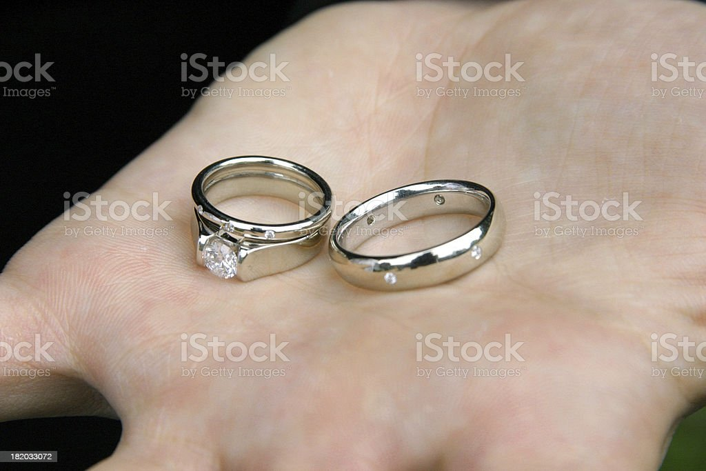 bride and grooms wedding rings shown in outstretched palm royalty free stock photo - Grooms Wedding Ring