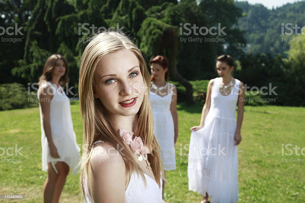 Bride and her friends in the back royalty-free stock photo