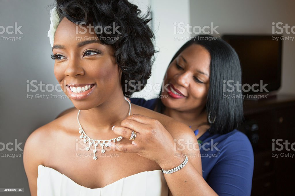 Bride and mother on her wedding day stock photo