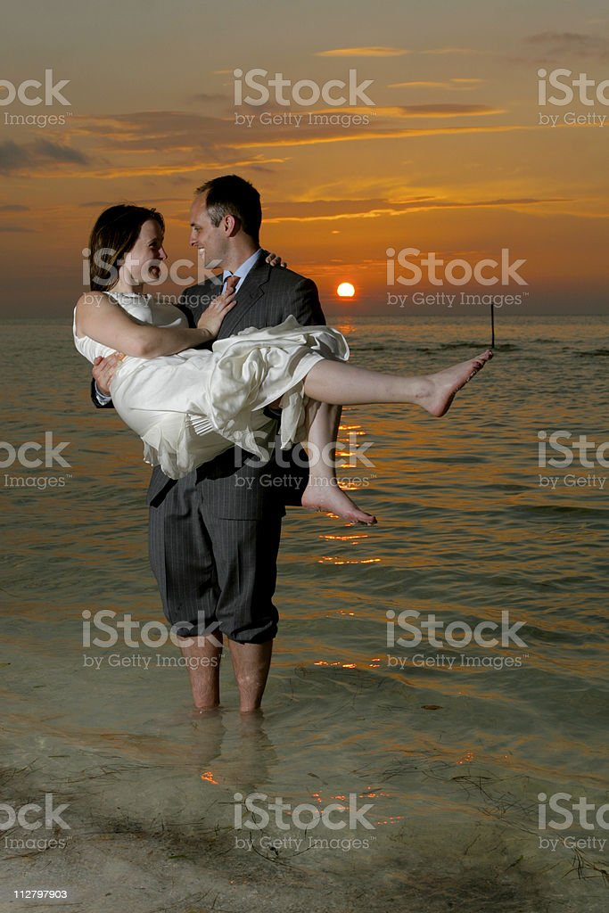 Bride being Carried Away by Groom at Mexican wedding celebration royalty-free stock photo