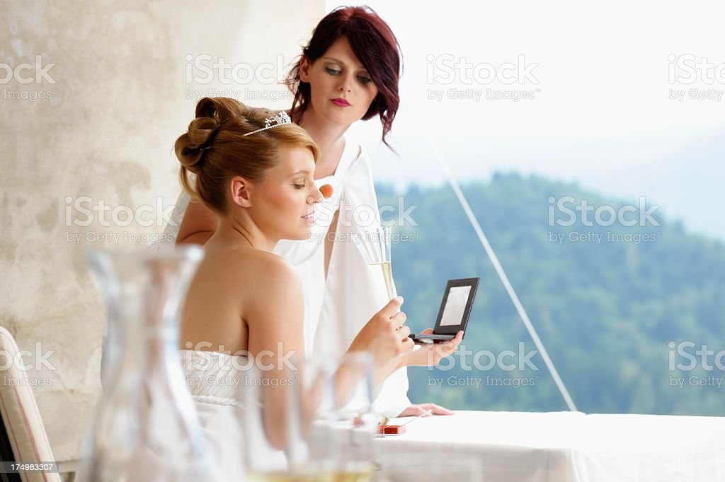 Bride Being Groomed/ Made-up royalty-free stock photo