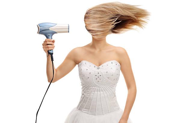 bride blowing her hair with a hair dryer - haarfön stock-fotos und bilder