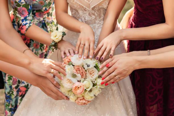 Bride, bridesmaids and wedding bouquet stock photo