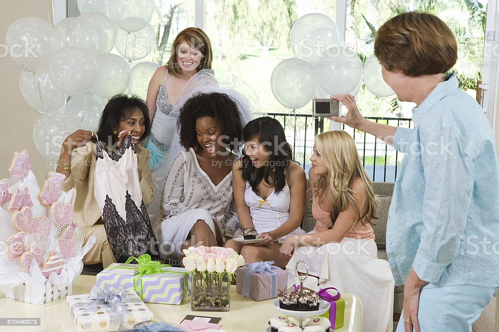 Bride celebrating at bridal shower with friends stock photo