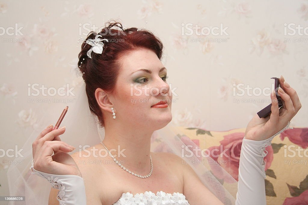 Bride dyes lips royalty-free stock photo