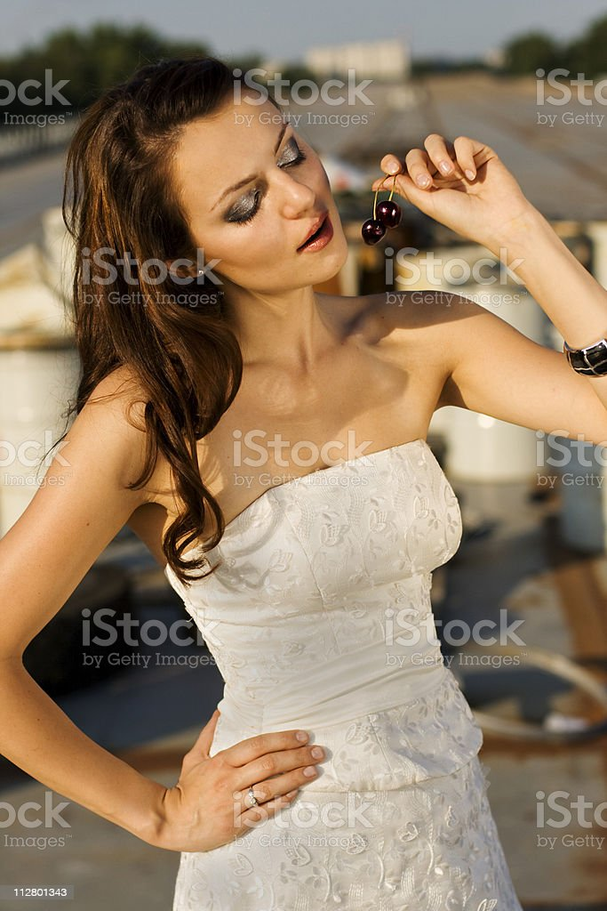Bride eating cherry royalty-free stock photo