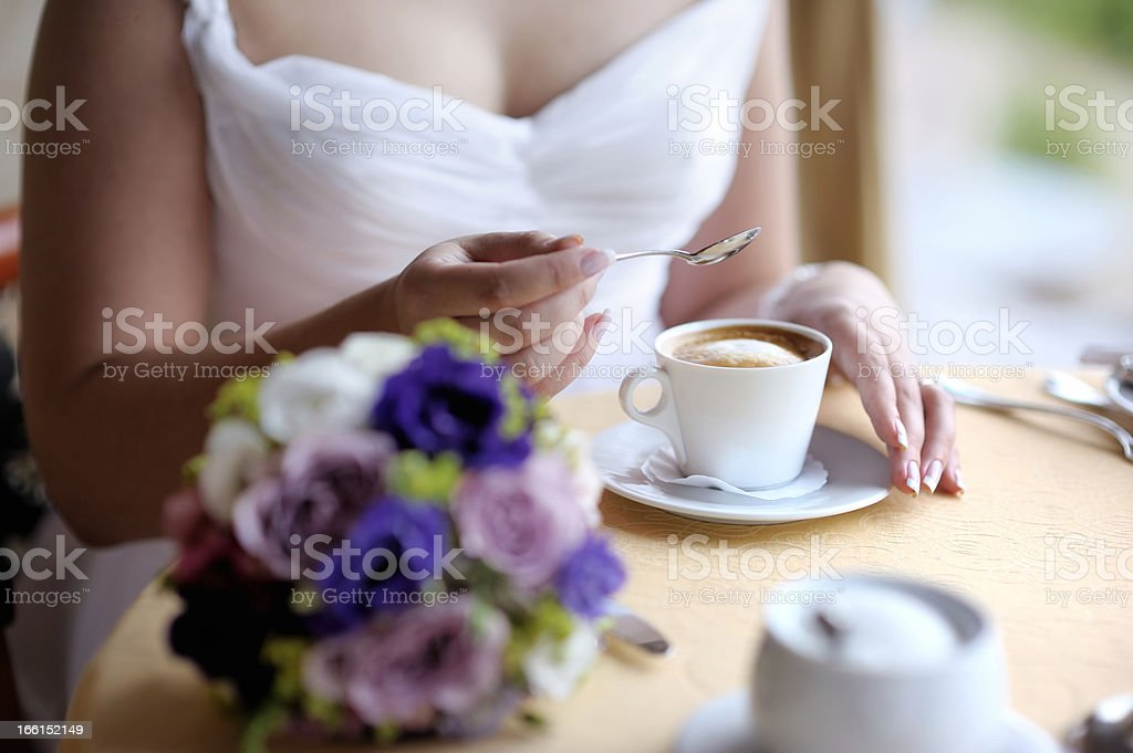 Bride enjoying a cup of coffee royalty-free stock photo
