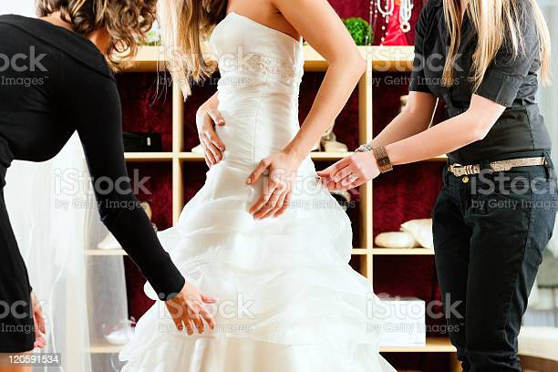 A Bride Fitting Her Wedding Dress In The Shop Stock Photo - Download Image Now