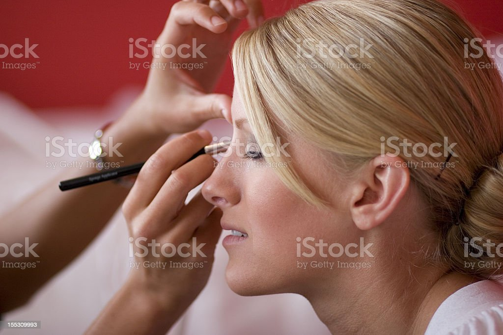 Bride getting make up on royalty-free stock photo