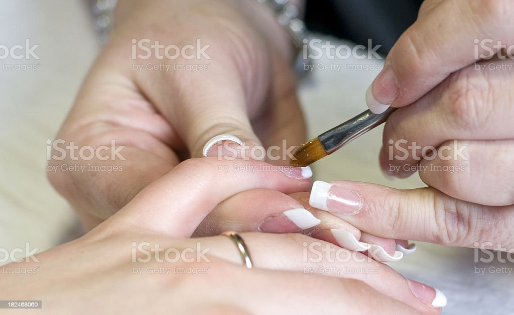 Bride getting manicure on fingernails royalty-free stock photo