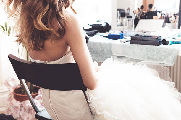 Bride getting ready on wedding day stock photo