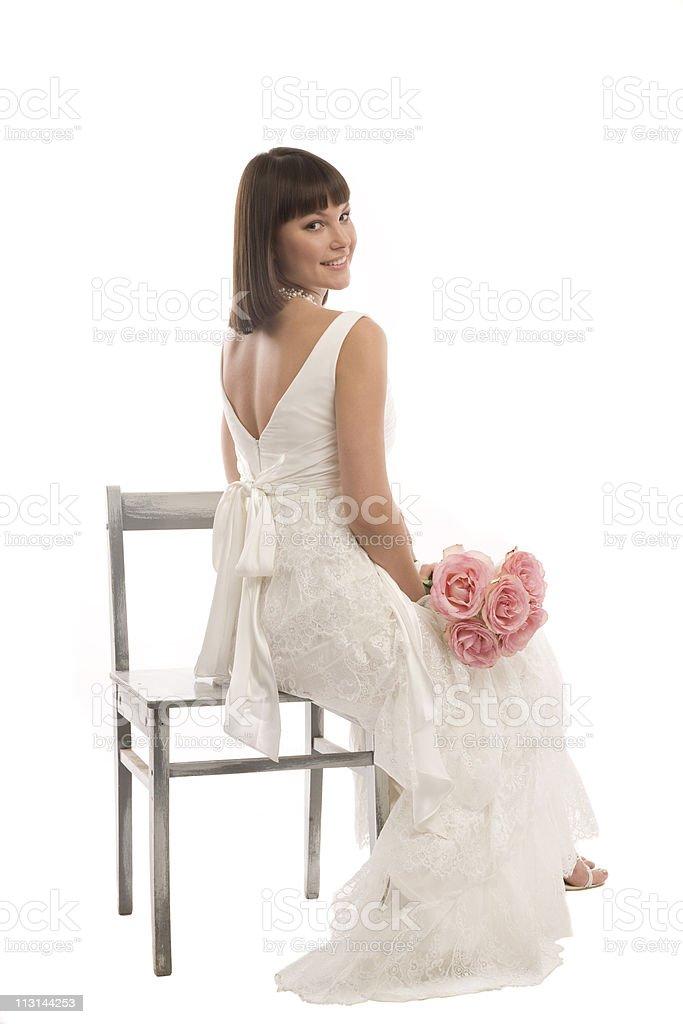 Bride glances over her shoulder. stock photo