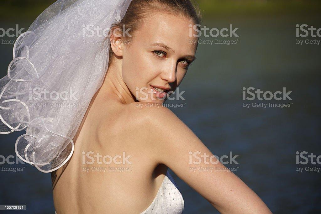 Bride glances over her shoulder royalty-free stock photo