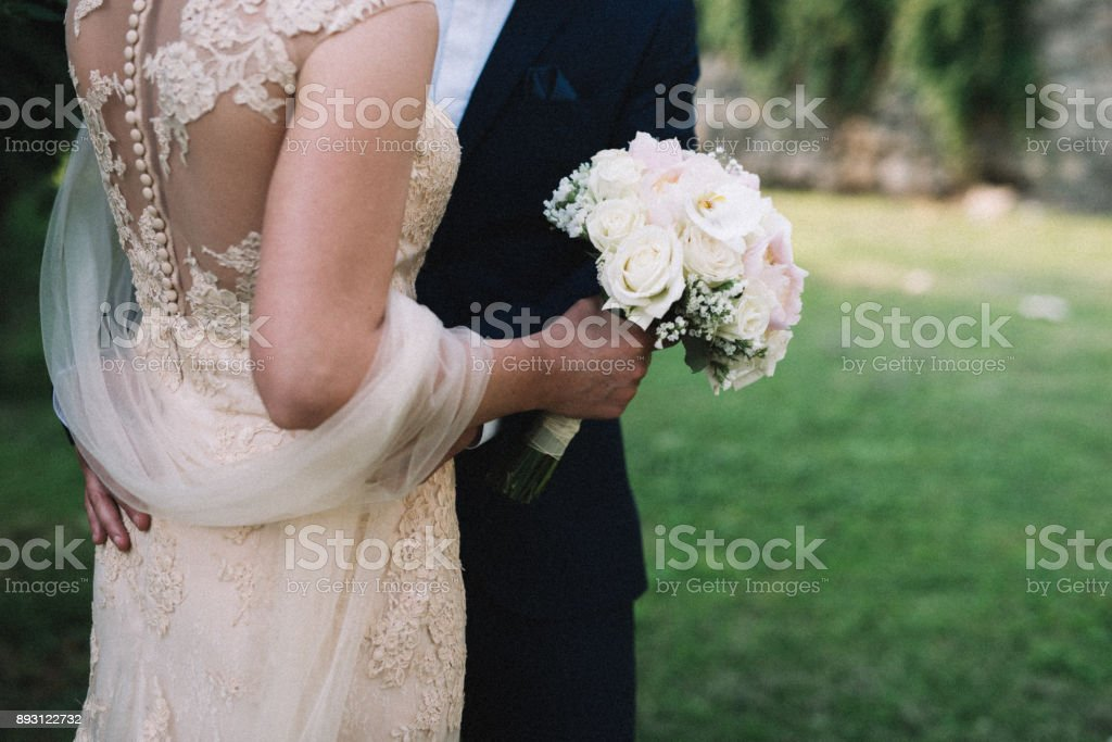 Bride, Groom and bouquet Stock Image - Stock image stock photo