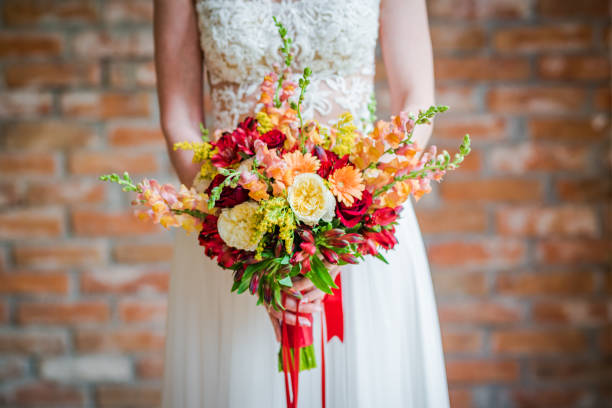 Bride holding a beautiful boho bouquet made of red and yellow fresh picture id1167714960?b=1&k=6&m=1167714960&s=612x612&w=0&h=idrbpr5fwogjz6hrwbiffx8iquikoxe7wiriiizu2uy=