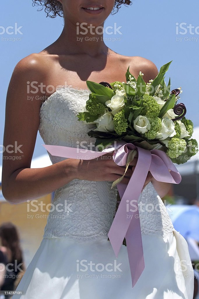 Bride holding a bouquet royalty-free stock photo